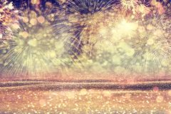 Abstract vintage background with multicolored fireworks. New Yea. New Year`s fireworks. Abstract festive background in vintage colors stock images