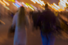 Abstract vintage tone motion. Blurred image of Street, girl and guy walking along the sidewalk city lights. Concept of. Abstract vintage tone motion. Blurred Stock Images