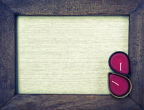 Abstract vintage wooden frame and red candle Stock Photos