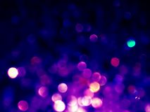Abstract violet bokeh circles background. Abstract violet and pink bokeh circles on blue background. Beautiful blue bokeh texture Royalty Free Stock Photos