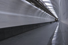 Abstract walking tunnel. Abstract grey tunnel with lift door at the ends Stock Photos