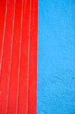 Abstract wall. Close up of a wall, with blue stucco and red wood trim Royalty Free Stock Photos