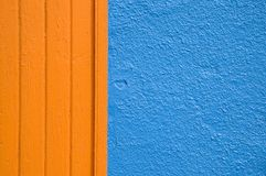 Abstract wall. Close up of a wall, with blue stucco and orange wood trim Royalty Free Stock Photography