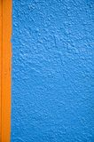 Abstract wall. Close up of a wall, with blue stucco and orange wood trim Stock Photo
