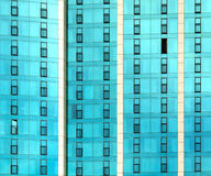 Abstract wall. A fraction of a glass wall of a building, with the pattern of balconies and doors creating an abstract composition Stock Image
