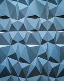 Abstract wallpaper or geometrical background consisting of blue geometric shapes: triangles and polygons Royalty Free Stock Image