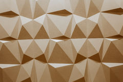 Abstract wallpaper or geometrical background consisting of warm or orange geometric shapes: triangles and polygons. Royalty Free Stock Photography