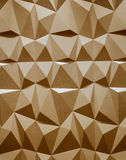 Abstract wallpaper or geometrical background consisting of warm or orange geometric shapes: triangles and polygons. Royalty Free Stock Images
