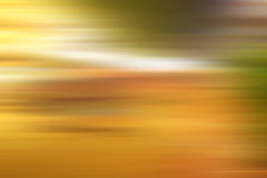 Abstract warm yellow background. Motion blur Stock Photos