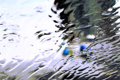 Abstract water. A view of a windshield of a car washed with water Stock Image