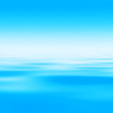 Abstract Water Background. Bright sky at morning with water surface (blank space for text Royalty Free Stock Image