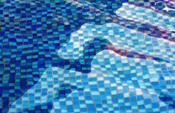 Abstract water. Background of a bottom from a blue tile under water in pool Stock Photo
