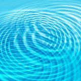 Abstract water background with circles ripples. Abstract bright blue water background with circles ripples Stock Image