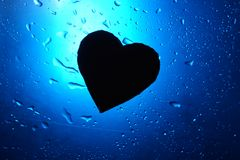 Abstract water drop background blue light spot heart silhouette stock images