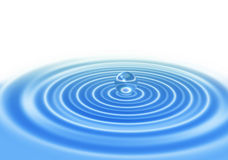Abstract water drop on blue water surface Stock Image