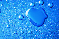 The Abstract water drop on surface of  fresh blue background Royalty Free Stock Image