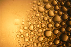 Abstract water drops. On scratched surface Stock Photos
