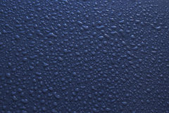 Abstract Water Drops Background. Water drops on a black background with a slight blue tint Stock Images
