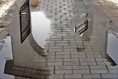 Abstract water reflection of gates. Kremlin in Kolomna, Russia Royalty Free Stock Photo