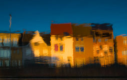 Abstract water reflexions  with colored houses background Royalty Free Stock Photos
