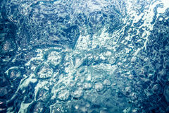 Abstract water whirlpool with bubbles and ripples Stock Images