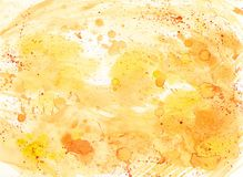 Abstract watercolor background with drops in yellow and orange colors. Stock Photos