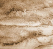 Abstract watercolor background on paper texture. In Sepia toned. Stock Photos