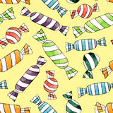 Abstract watercolor candy seamless pattern on the yellow background Stock Images