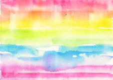Abstract watercolor hand painted rainbow background royalty free stock photo