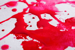 Abstract watercolor paint splash on paper texture. Background, red drops on white wall, top view, modern art stock photo