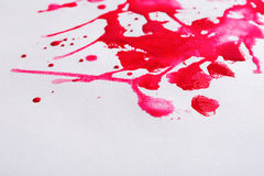 Abstract watercolor paint splash on paper texture. Background, red drops on white wall, top view, modern art royalty free stock photo