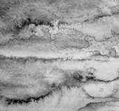 Abstract watercolor on paper texture as background. In black and Royalty Free Stock Photography