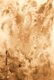 Abstract watercolor on paper texture as  background. In Sepia to Royalty Free Stock Images