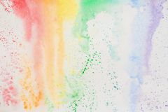 Abstract watercolor stains, iridescent texture in colorful shades of vivid bright colors on white paper, rainbow. Current watercolor for background stock photo