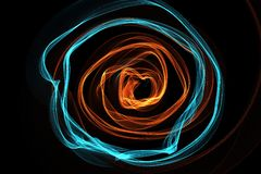 Abstract wave motion glowing lines on dark background. Circle Waves of glowing lines in different shapes and colors Royalty Free Stock Image