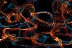Abstract wave motion glowing lines on dark background Royalty Free Stock Photos