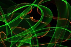 Abstract wave motion glowing lines on dark background. Waves of glowing lines in different shapes and colors royalty free illustration