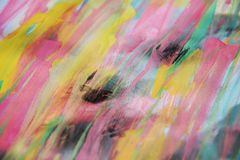 Abstract waves pink blue green background on burnt paper. Pink, yellow, black, dark and pastel waves hues on burnt background, abstract pattern background. Hand Royalty Free Stock Images