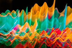 Abstract wavy color lights in motion.   Royalty Free Stock Photos
