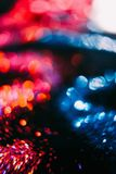 Abstract colorful glitter contrast background. Abstract wavy sparkling glitter on contrast black background. Defocused bokeh concept Stock Photo
