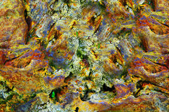 Abstract weathered colorful rock Stock Photography