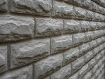 Abstract weathered texture stained old stucco light gray and aged paint white brick wall background in rural room royalty free stock photography