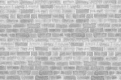 Abstract weathered texture stained old stucco light gray and aged paint white brick wall background in rural room, grungy rusty bl. Ocks of stonework technology royalty free stock image