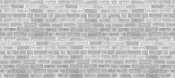 Abstract weathered texture stained old stucco light gray and aged paint white brick wall background in rural room, grungy rusty bl. Ocks of stonework technology royalty free stock images