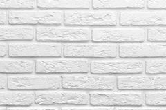 Abstract weathered texture stained old stucco light gray white brick wall background, grungy blocks of stonework Stock Image