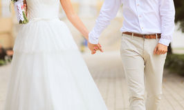 Abstract wedding photo couple bride and groom holds hands walks Royalty Free Stock Images