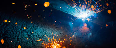 Abstract welding sparks light, industrial background royalty free stock photo