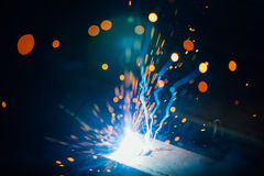 Abstract welding sparks light, industrial background stock photography