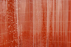 Abstract wet shower curtain. Abstract clear wet shower curtain with tiles in background Stock Photography