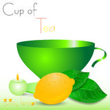 Abstract white background with green cup of tea and lemon Royalty Free Stock Photo